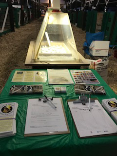 South Jersey Quail Project literature on a green tablecloth, in the background is an intubator.